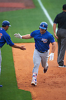 Iowa Cubs designated hitter Dan Vogelbach (20) congratulated by hitting coach Brian Harper (36) after hitting a home run during a game against the Nashville Sounds on May 4, 2016 at First Tennessee Park in Nashville, Tennessee.  Iowa defeated Nashville 8-4.  (Mike Janes/Four Seam Images)
