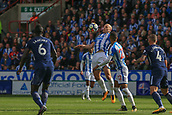 30th September 2017, The John Smiths Stadium, Huddersfield, England; EPL Premier League football, Huddersfield Town versus Tottenham Hotspur; Aaron Mooy of Huddersfield Town chests the ball