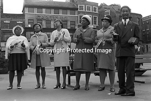 Sunday afternoon Derby town centre. Afro Caribbean church group evangelising, Derbyshire, England 1970