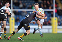 Andy Fenby is tackled by Chris Bell. Aviva Premiership match, between London Wasps and London Irish on February 15, 2014 at Adams Park in High Wycombe, England. Photo by: Patrick Khachfe / JMP