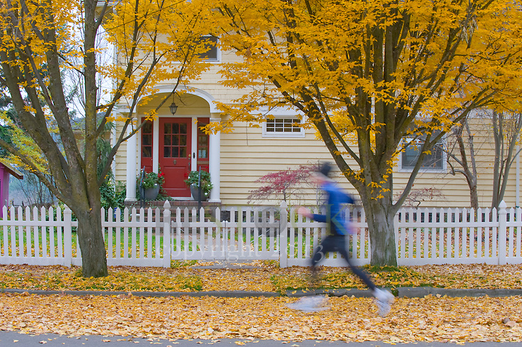 Runner in front of Yellow House
