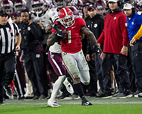 ATHENS, GA - NOVEMBER 23: D'Andre Swift #7 of the Georgia Bulldogs is tackled by Elijah Blades #2 of the Texas A