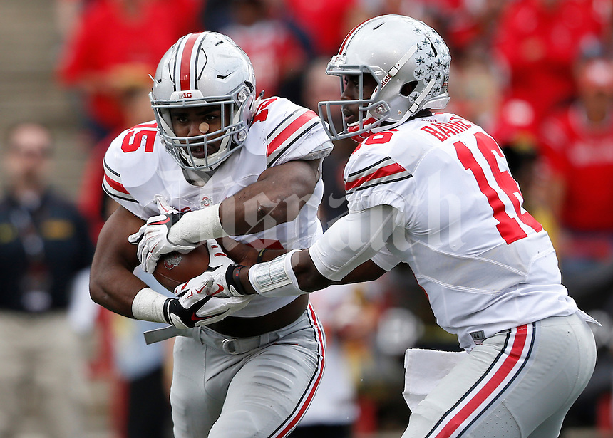 Ohio State Buckeyes running back Ezekiel Elliott (15) takes the hand-off from quarterback J.T. Barrett (16) during the third quarter of the NCAA football game at Byrd Stadium in College Park, Maryland on Oct. 4, 2014. (Adam Cairns / The Columbus Dispatch)