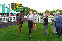 Winner of The Graham Fitch Birthday Celebration Classified Stakes Pempie ridden by Oisin Murphy and trained by Andrew Balding is led into the Winners enclosure during Evening Racing at Salisbury Racecourse on 25th May 2019