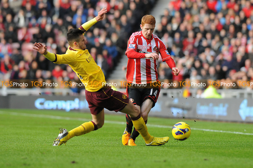 Arsenal's Carl Jenkinson tackles Jack Colback of Arsenal - Sunderland vs Arsenal - Barclays Premier League Football at The Stadium of Light, Sunderland, Tyne & Wear - 09/02/13 - MANDATORY CREDIT: Steven White/TGSPHOTO - Self billing applies where appropriate - 0845 094 6026 - contact@tgsphoto.co.uk - NO UNPAID USE.