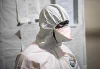 Mary Beth Heffernan, professor of art and art history at Occidental College, works in Monrovia the capital of Liberia, Africa in 2015. Professor Heffernan was there to work on her PPE (personal protective equipment) Portrait Project, which helps health care workers and patients fighting the Ebola virus disease in West Africa.<br /> (Photo by Marc Campos, Occidental College Photographer)