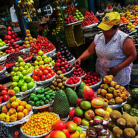 A Colombian vendor sets up piles of fruit in the market of Paloquemao in Bogotá, Colombia, 25 November 2017.
