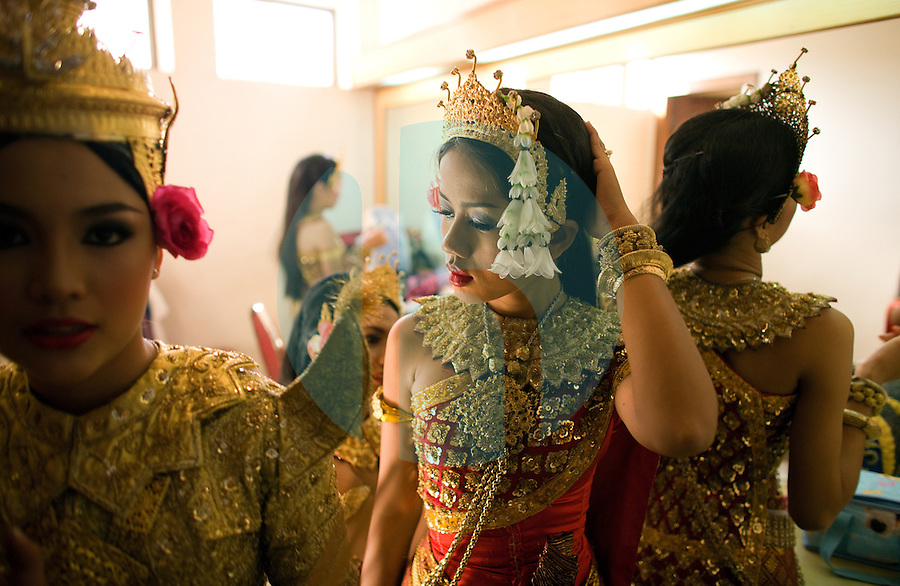 June 6th, 2008_Phnom Penh, Cambodia_ Dance troop members from the National School of Fine Arts, make final preparations back stage, before performing the newly revived work of Preah Anruch Preah Neang Ossa.  It has been some 50 years, since this classical Khmer dance piece was performed publicly and is being produced by the Amrita Performing Arts Association.   Photographer: Daniel J. Groshong/Tayo Photo Group