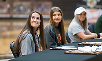 NWA Democrat-Gazette/BEN GOFF @NWABENGOFF<br /> Carrie Kotoucek (from left), Brianna Willis and Taylor Muff, Bentonville soccer players, listen as their coach makes remarks Wednesday, Feb. 6, 2019, during a signing ceremony at Bentonville's Tiger Arena.