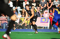NZ's Nick Wilson looks for support during the international hockey match between the New Zealand Black Sticks and Malaysia at Fitzherbert Park, Palmerston North, New Zealand on Sunday, 9 August 2009. Photo: Dave Lintott / lintottphoto.co.nz