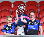 Kilkee/Kilbaha joint captains Susan Mc Grath and Aine Bonfil collect the trophy following their Schools Division 6 final at Cusack Park. Photograph by John Kelly