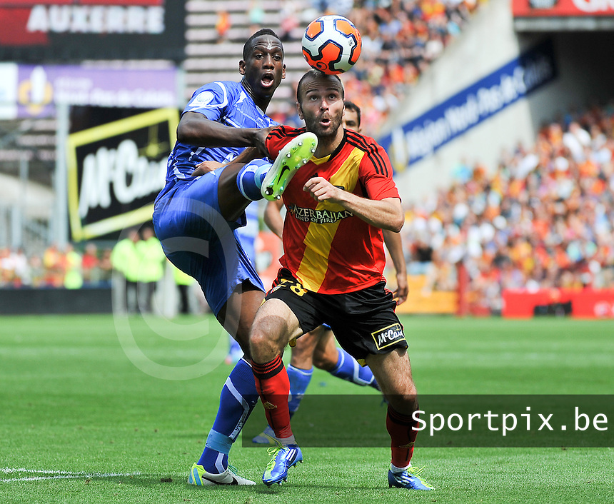 RC Lens - AJ Auxerre : Willy Boly defending on Danijel Ljuboja (right)<br /> foto David Catry / nikonpro.be