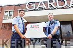 Garda Aidan O'Mahoney and Eoghan Walsh at the Tralee Garda station on Friday as they launch their Walk the Camino in Portugal which will take place in early September as a fundraiser for Cardiac Risk in the Young (CRY).