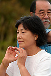 Asian woman doing Tai Chi