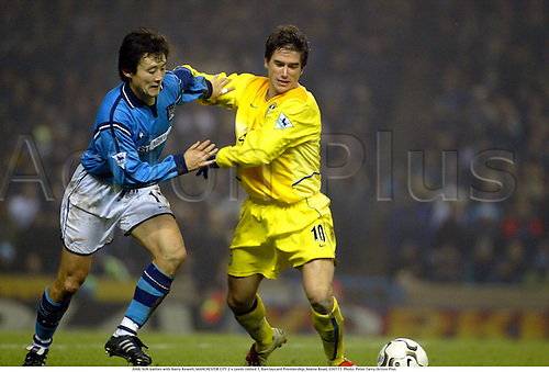 11th March 2003, Manchester, Lancashire, England; JIHAI SUN battles with Harry Kewell, MANCHESTER CITY 2 v Leeds United 1, Barclaycard Premiership, Maine Road