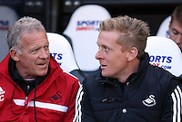 Pictured L-R: Swansea First team coach Alan Curtis and head coach Garry Monk. Saturday 19 April 2014<br />