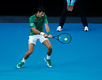 2nd February 2020; Melbourne Park, Melbourne, Victoria, Australia; Australian Open Tennis, Mens singles final on Day 14; Novak Djokovic of Serbia returns during his singles final match against Dominic Thiem of Austria