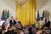 Irish Prime Minister Enda Kenny (2nd,L) makes remarks as United States President Barack Obama listens along with first lady Michelle Obama (2nd,R), Kenny's wife Fionnuala (3rd,R) and Vice President Joe Biden (R) during a reception in the East Room of the White House, March 20, 2012, in Washington, DC. The two leaders concluded a working day devoted to discussions on economic matters, Ireland's peace keeping participations and foreign policy issues like Syria and Iran. .Credit: Mike Theiler / Pool via CNP