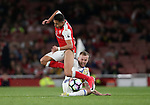 Arsenal's Alexis Sanchez gets caught by Sunderland's Sebastian Larsson during the Premier League match at the Emirates Stadium, London. Picture date: May 16th, 2017. Pic credit should read: David Klein/Sportimage