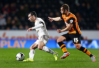 Leon Britton of Swansea City and Shaun Maloney of Hull City during the Capital One Cup match between Hull City and Swansea City played at the Kingston Communications Stadium, Hull