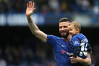 Chelsea's Olivier Giroud waves to the home fans as he walks around the pitch with members of his family after the final whistle during Chelsea vs Watford, Premier League Football at Stamford Bridge on 5th May 2019