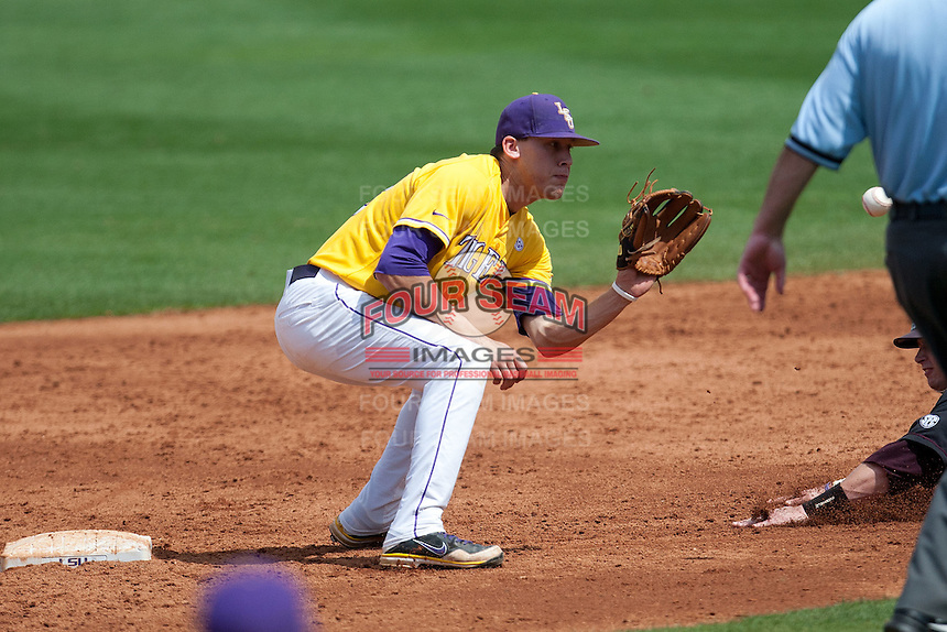 LSU Tigers second baseman JaCoby Jones #23 receives the catchers throw during the NCAA baseball game against the Mississippi State Bulldogs on March 18, 2012 at Alex Box Stadium in Baton Rouge, Louisiana. LSU defeated Mississippi State 4-2. (Andrew Woolley / Four Seam Images).