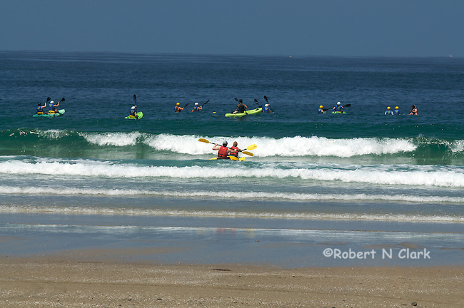 Kayakers getting started at La Jolla Shores, paddles up