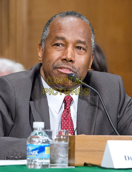 Dr. Benjamin Carson testifies before the United States Senate Committee on Banking, Housing, and Urban Affairs during a confirmation hearing on his nomination to be Secretary of Housing and Urban Development (HUD) on Capitol Hill in Washington, DC on Thursday, January 12, 2017.<br /> CAP/MPI/RS/CNP<br /> &copy;RS/CNP/MPI/Capital Pictures