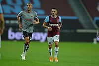 Manuel Lanzini of West Ham United and Macauley Bonne of Charlton Athletic FC during West Ham United vs Charlton Athletic, Caraboa Cup Football at The London Stadium on 15th September 2020