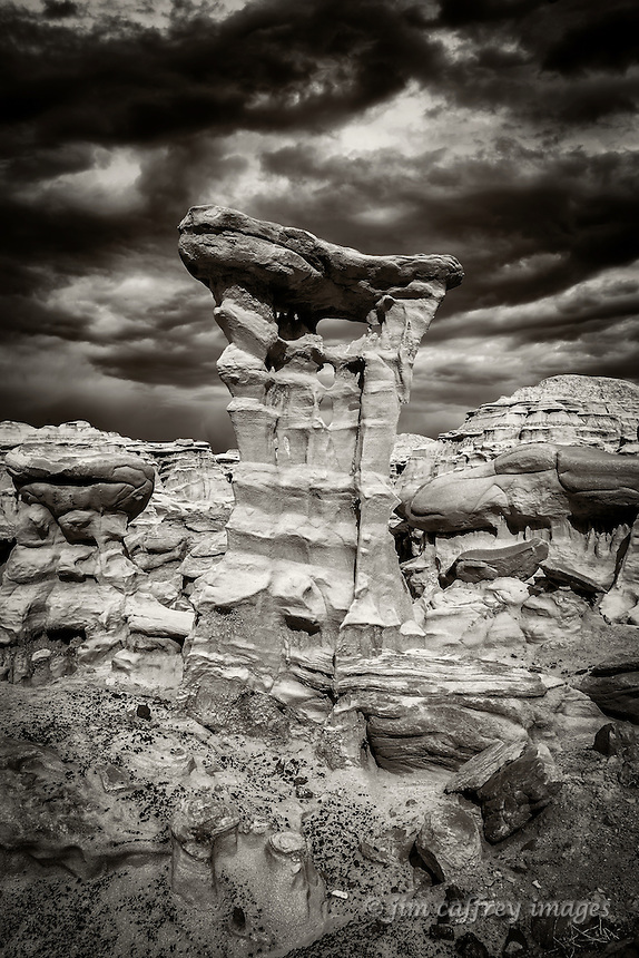 A sepia toned image of a bizarre formation in a small badlands area along the edge of Ah Shi Sle Pah Wash in New Mexico's San Juan Basin