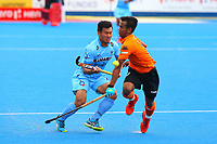Faizal Saari of Malaysia and Chinglensana Kangujam of India during the Hockey World League Quarter-Final match between India and Malaysia at the Olympic Park, London, England on 22 June 2017. Photo by Steve McCarthy.