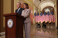 WASHINGTON, DC - JANUARY 08: Speaker of the House Nancy Pelosi (D-CA) (R) and Senate Minority Leader Charles Schumer (D-NY) pose for photographs after delivering a televised response to President Donald Trump's national address about border security at the U.S. Capitol January 08, 2019 in Washington, DC. Republicans and Democrats seem no closer to an agreement on security along the southern border and ending the partial federal government shutdown, the second-longest in history. <br /> CAP/MPI/RS<br /> &copy;RS/MPI/Capital Pictures