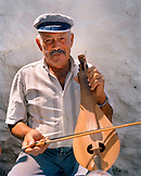 GREECE, Patmos, Diakofti, Dodecanese Island, portrait of Mihais Grillakis with his lyra, the owner of Taverna Diakofti
