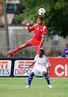 Roberto Chen (5) of Panama goes over the top of Javier Aquilar (16) during the group stage of the CONCACAF Men's Under 17 Championship at Jarrett Park in Montego Bay, Jamaica. Panama tied Cuba, 0-0.