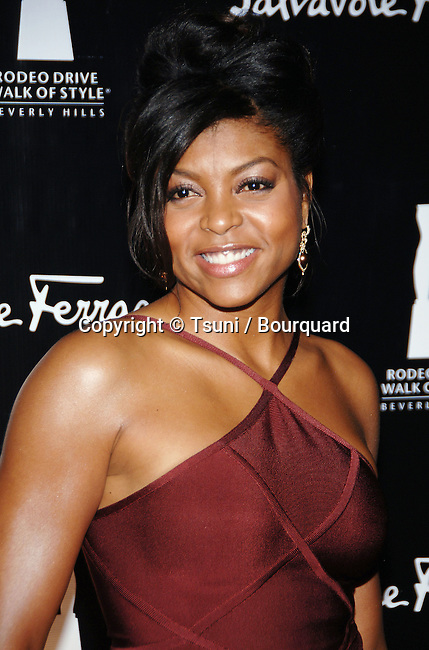 Taraji Henson arriving at the SALVATORE FERRAGAMO RODEO WALK OF STYLE AWARDS In Los Angeles.<br /> <br /> headshot<br /> smile
