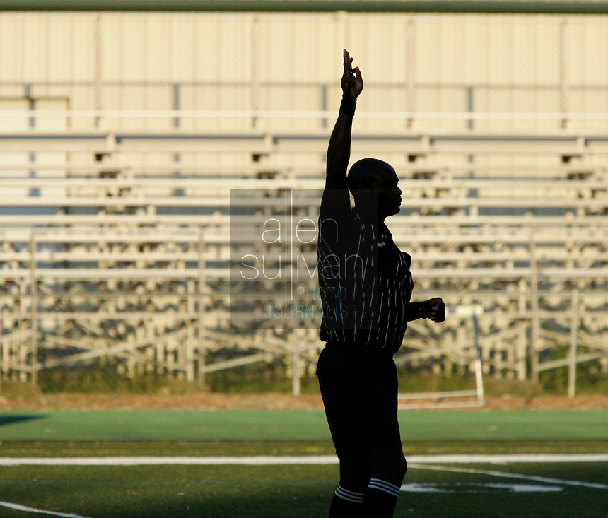 A soccer referee in the first half of a semifinal match at Harrison High School in Kennesaw, Ga. on Wednesday, May 9, 2007.