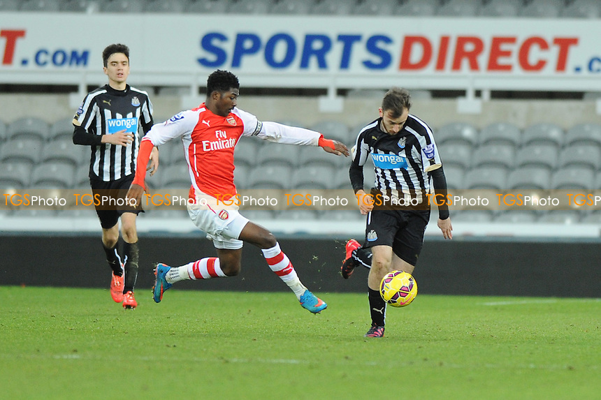 Alex Gilliead of Newcastle United battles with Ainsley Maitland-Niles - Newcastle United Under-21 vs Arsenal Under-21 - Barclays Under-21 Premier League Football at St James Park, Newcastle United FC - 09/02/15 - MANDATORY CREDIT: Steven White/TGSPHOTO - Self billing applies where appropriate - contact@tgsphoto.co.uk - NO UNPAID USE
