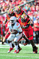 The Terrapins' defense swarm Buckeyes' quarterback J.T. Barrett. Ohio State trounced Maryland 52-24 during a game at the Capital One Field in Byrd Stadium, College Park, MD on Saturday, October 4, 2014.  Alan P. Santos/DC Sports Box