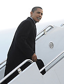 Chicago, IL - January 4, 2009 -- United States President-elect Barack Obama climbs the stairs to board his plane as he departs for Washington, DC, USA from Midway Airport in Chicago, Illinois, USA 04 January 2009. Obama will join his wife and children who are already in Washington as he prepares to take office on 20 January 2009. .Credit: Tannen Maury - Pool via CNP