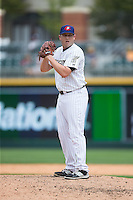 Charlotte Knights relief pitcher Blake Smith (19) looks to his catcher for the sign against the Gwinnett Braves at BB&T BallPark on July 3, 2015 in Charlotte, North Carolina.  The Braves defeated the Knights 11-4 in game one of a day-night double header.  (Brian Westerholt/Four Seam Images)
