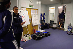 Macclesfield Town 0 Gateshead 4, 22/02/2013. Moss Rose, Football Conference. Players and coaches gathering in the home dressing room before Macclesfield Town host Gateshead at Moss Rose in a Conference National fixture. The visitors from the North East who were in the relegation zone, shocked Macclesfield with four first half goals and won 4-0 in front of 1467 fans. Both teams were former members of the Football league, with Macclesfield dropping out in 2012. Photo by Colin McPherson.