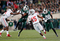 Ohio State Buckeyes running back Ezekiel Elliott (15) runs for a big gain in the first quarter of the college football game between the Ohio State Buckeyes and the Michigan State Spartans at Spartan Stadium in East Lansing, Saturday night, November 8, 2014. (The Columbus Dispatch / Eamon Queeney)
