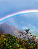 Rainbow as seen from Kalalau Lookout. Waimea Canyon. Kauai, Hawaii,ocean,oceans,oceanic,sea,seas,seascape,<br /> seascapes,beach,beaches,coast,surf,<br /> coastline,coastlines,coast line,coast lines,coastal,shore,shores,shoreline,shorelines,<br /> shore line,shore lines,beachshore,seashore,<br /> sea shore,body of water,seaside,waterfront,coastal region