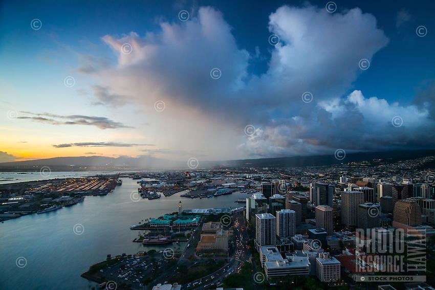 An aerial view at dusk of Honolulu Harbor and downtown Honolulu, O'ahu.