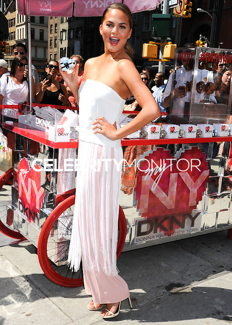NEW YORK CITY, NY, USA - AUGUST 19: Chrissy Teigen at the DKNY MYNY fragrance launch celebration held at Madison Square Park on August 19, 2014 in New York City, New York, United States. (Photo by Celebrity Monitor)