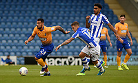 Mansfield Town's CJ Hamilton battles with Colchester United's Sean Murray<br /> <br /> Photographer Hannah Fountain/CameraSport<br /> <br /> The EFL Sky Bet League Two - Colchester United v Mansfield Town - Saturday 7th October 2017 - Colchester Community Stadium - Colchester<br /> <br /> World Copyright &copy; 2017 CameraSport. All rights reserved. 43 Linden Ave. Countesthorpe. Leicester. England. LE8 5PG - Tel: +44 (0) 116 277 4147 - admin@camerasport.com - www.camerasport.com