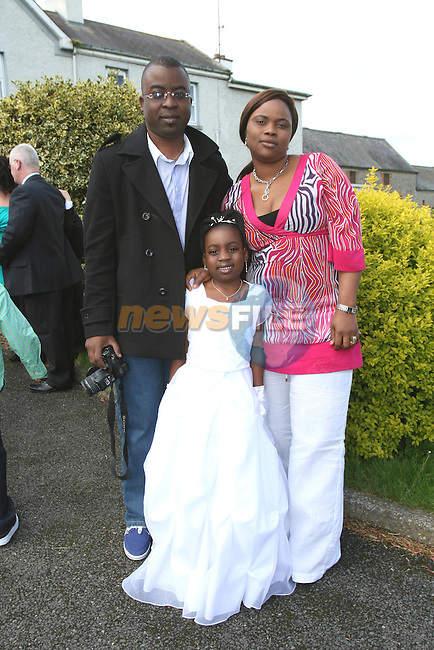 Zainab Apako with Chris Aina and Blessing Opasuyi at her Communion in Duleek Church...Photo NEWSFILE/Jenny Matthews.(Photo credit should read Jenny Matthews/NEWSFILE)....This Picture has been sent you under the condtions enclosed by:.Newsfile Ltd..The Studio,.Millmount Abbey,.Drogheda,.Co Meath..Ireland..Tel: +353(0)41-9871240.Fax: +353(0)41-9871260.GSM: +353(0)86-2500958.email: pictures@newsfile.ie.www.newsfile.ie.FTP: 193.120.102.198.