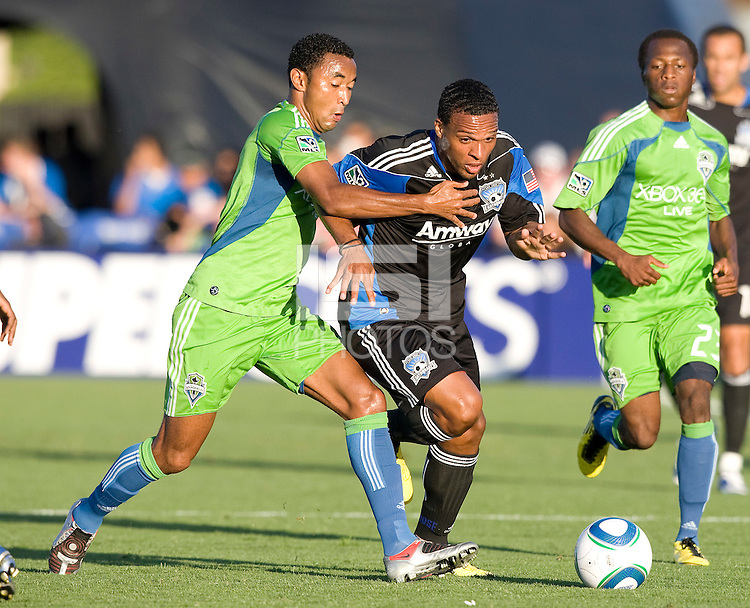 Scott Sealy of Earthquakes dribbles the ball away from James Riley of Sounders during the game at Buck Shaw Stadium in Santa Clara, California on July 31st, 2010.   Seattle Sounders defeated San Jose Earthquakes, 1-0.