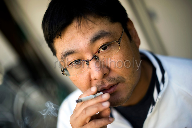 Toyoki Toshida, a suicide and credit counselor, outside his office in Saitama, just north of Tokyo, Japan. Drowning in debt, Yoshida attempted to take his own life 7 years ago, but today tries to stop others in similar situations from committing suicide on 06 Nov. 2009...