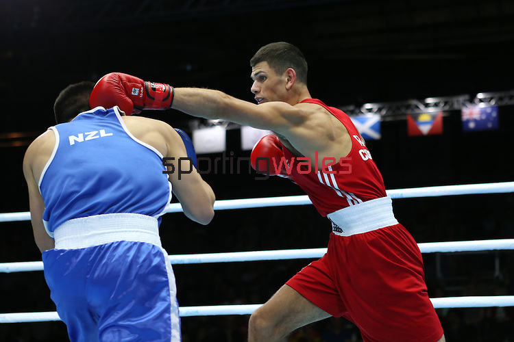 Glasgow 2014 Commonwealth Games<br /> Joseph Cordina, Wales (Red) v Chad Milnes, New Zealand (Blue)<br /> Men's Light (60kg)<br /> SECC<br /> 29.07.14<br /> ©Steve Pope-SPORTINGWALES